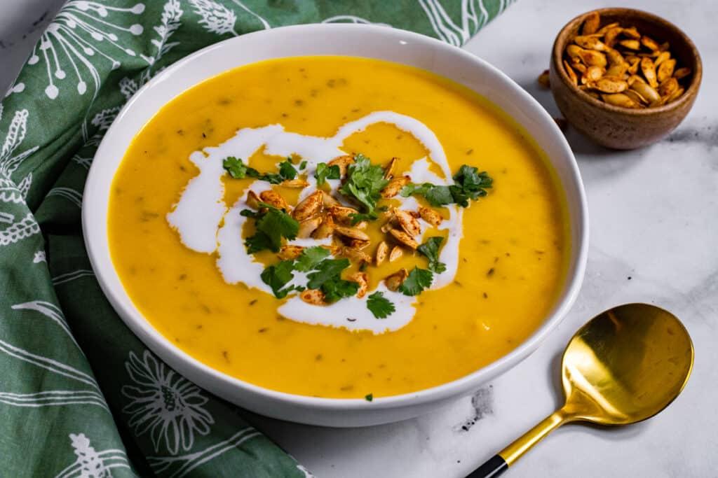 A bowl of vegan butternut Squash Carrot Ginger Soup