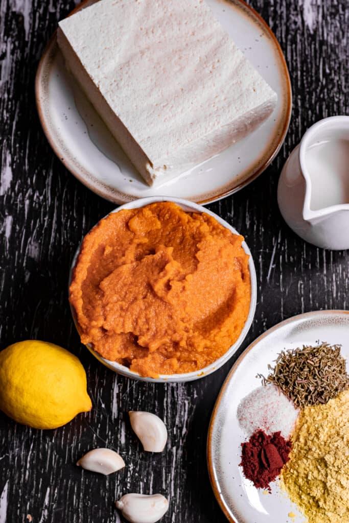 Pumpkin puree, tofu, plant milk, lemon and spices on a table