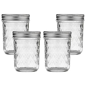 Small mason jars perfect for bringing sauces or hummus on the go