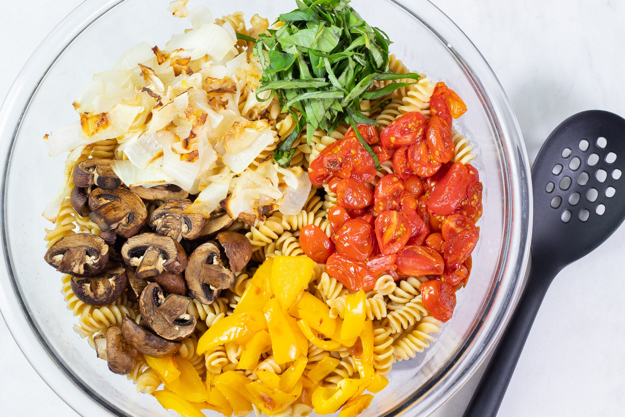Roasted Vegetables and Pasta in a Mixing Bowl