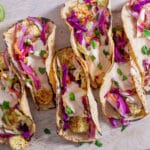 Overhead of six plant-based tacos