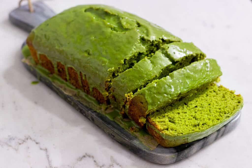 Green matcha pound cake on a gray stone slab