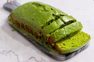 Green matcha pound cake on a gray stone slab