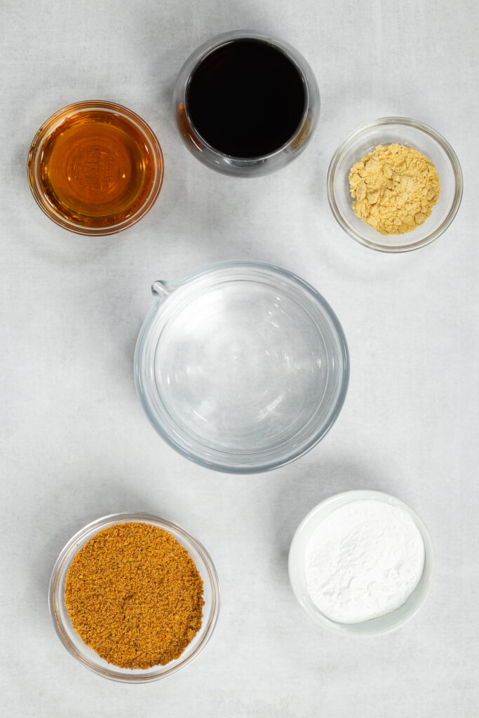 Tamari, maple syrup, gluten-free flour, spices and water in bowls and measuring cups