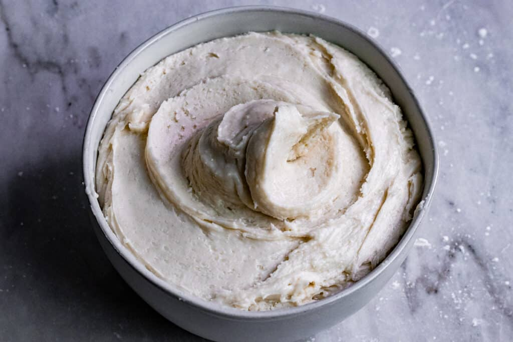 Bowl of vegan buttercream whipped into a spiral