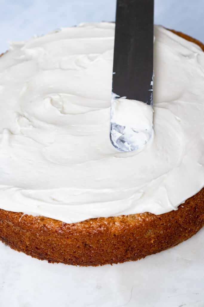 Icing the cake with an offset frosting spatula
