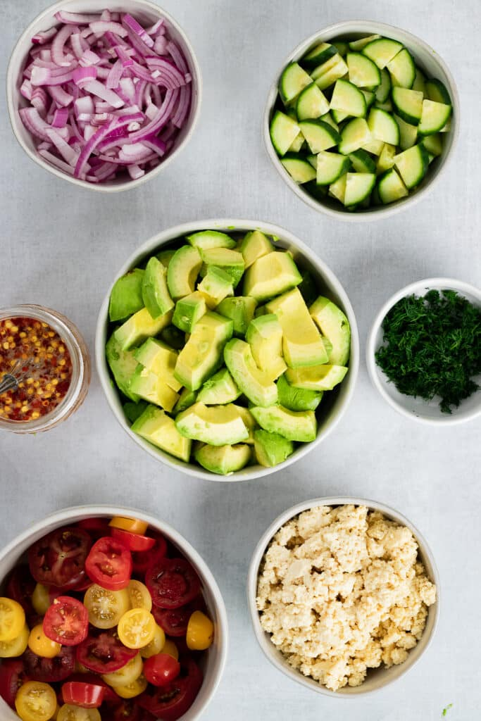 Avocado and other ingredients in bowls