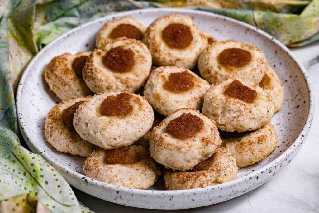 A plate of vegan thumbprint cookies