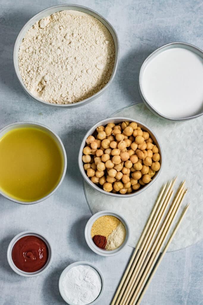 Ingredients in bowls with wooden skewers