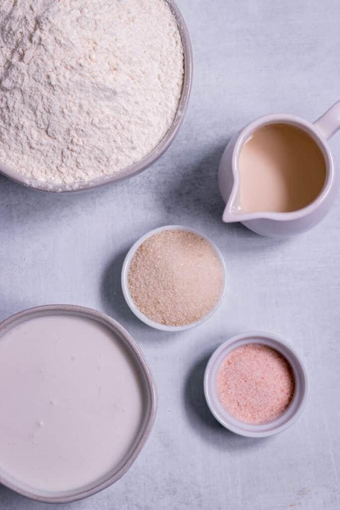 Flour, Coconut Cream, Sugar, Salt and Almond Milk on a table