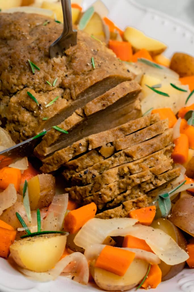 Seitan Turkey being carved on a plater
