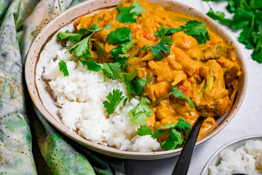 Bowl of vegan pumpkin curry in a bowl with rice