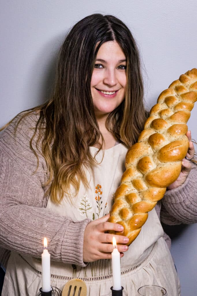 Liz Madsen hold a loaf of Challah