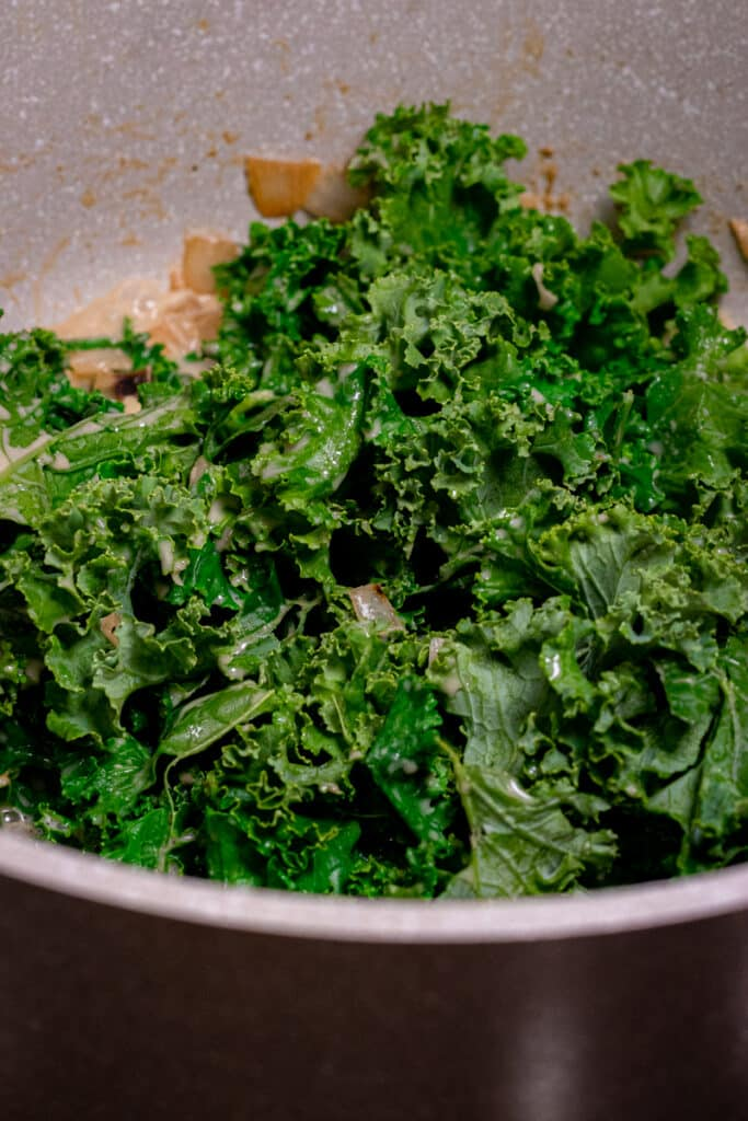 Kale cooking down in a pot
