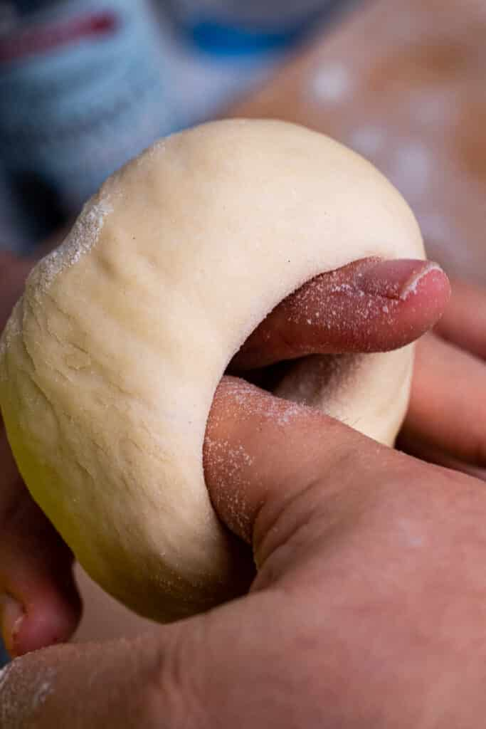 Forming dough into bagel rings