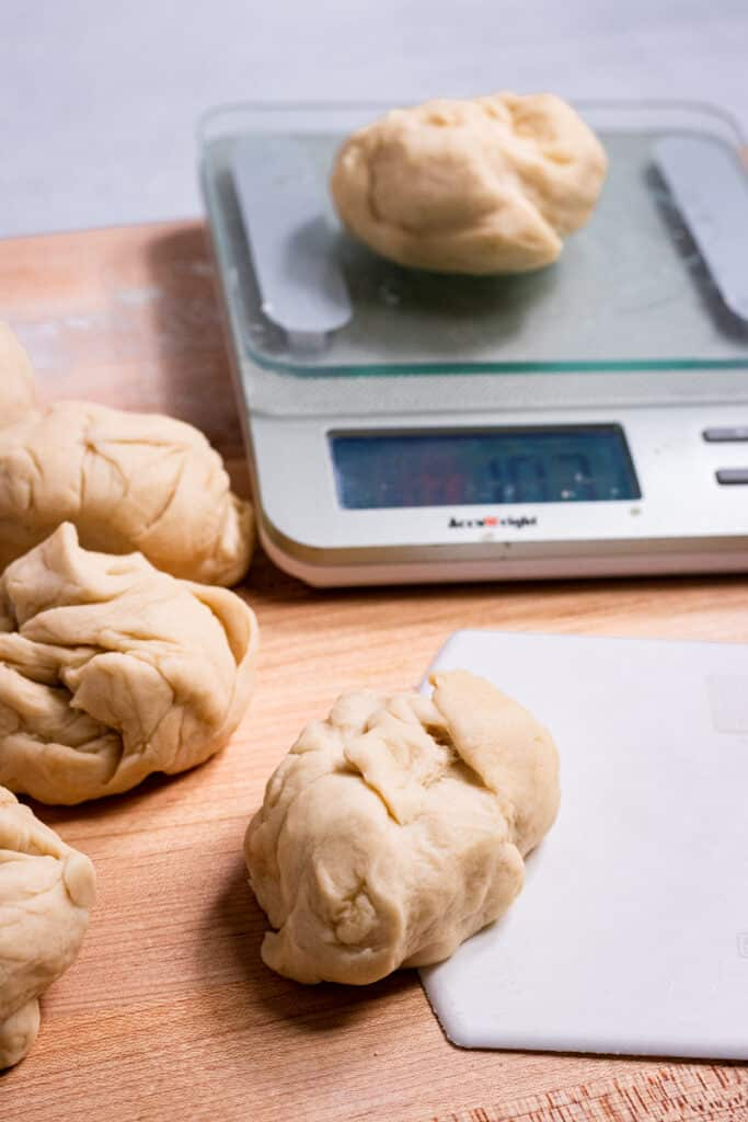 Measuring dough pieces on a food scale