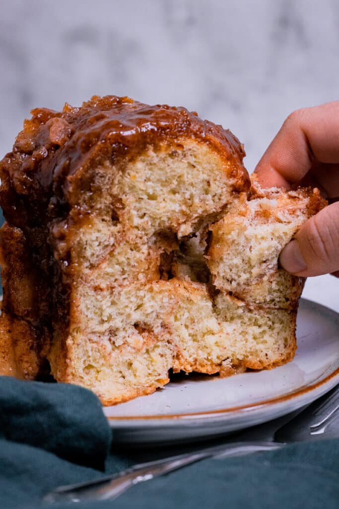 A slice of vegan monkey bread being pulled apart