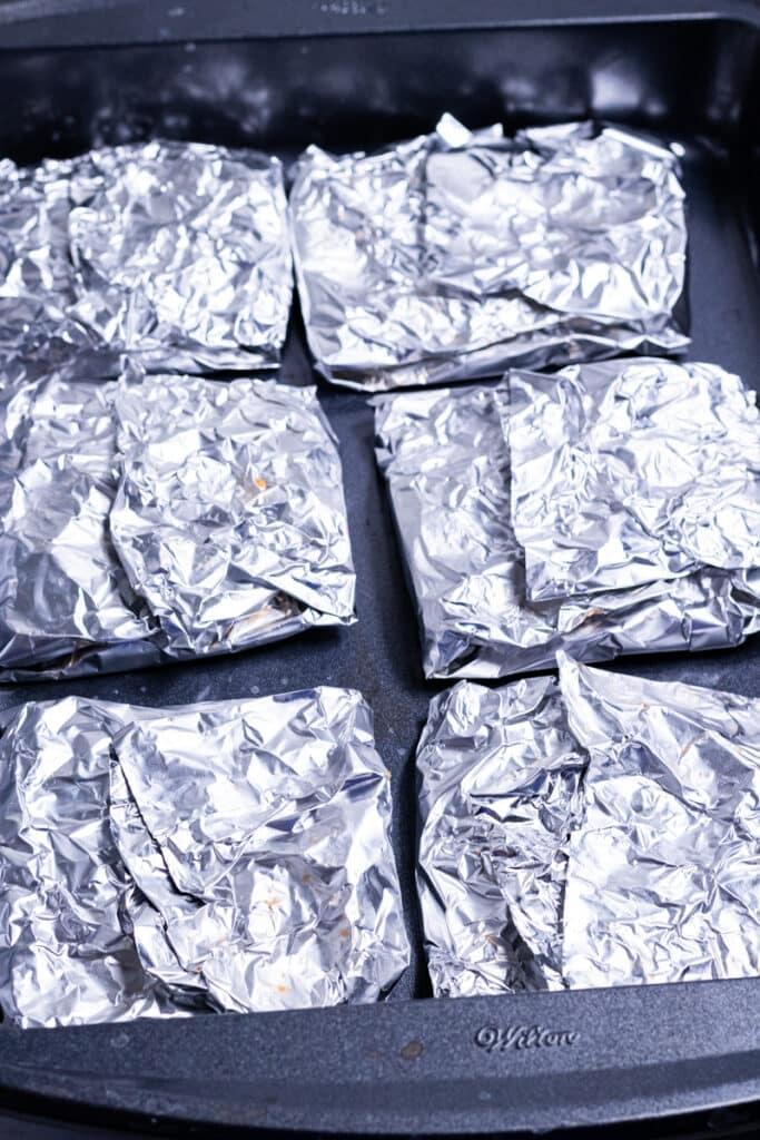Six schnitzel cutlets in aluminum foil