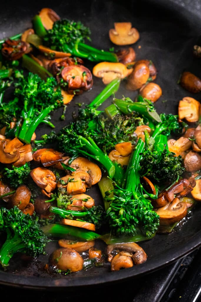 Cooking the broccoli and mushrooms in a pan