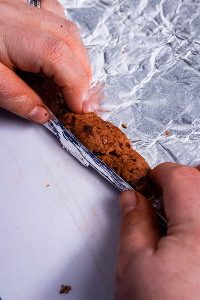 Rolling the dough into tin foil
