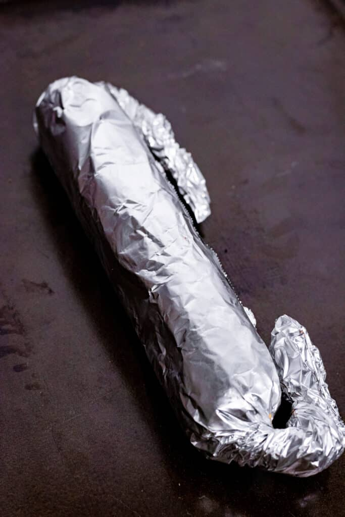Tin foiled sausage ends wrapped inwards