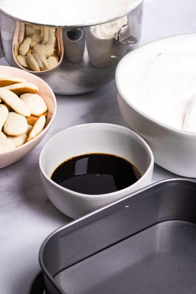 Ingredients in bowls with springform pan