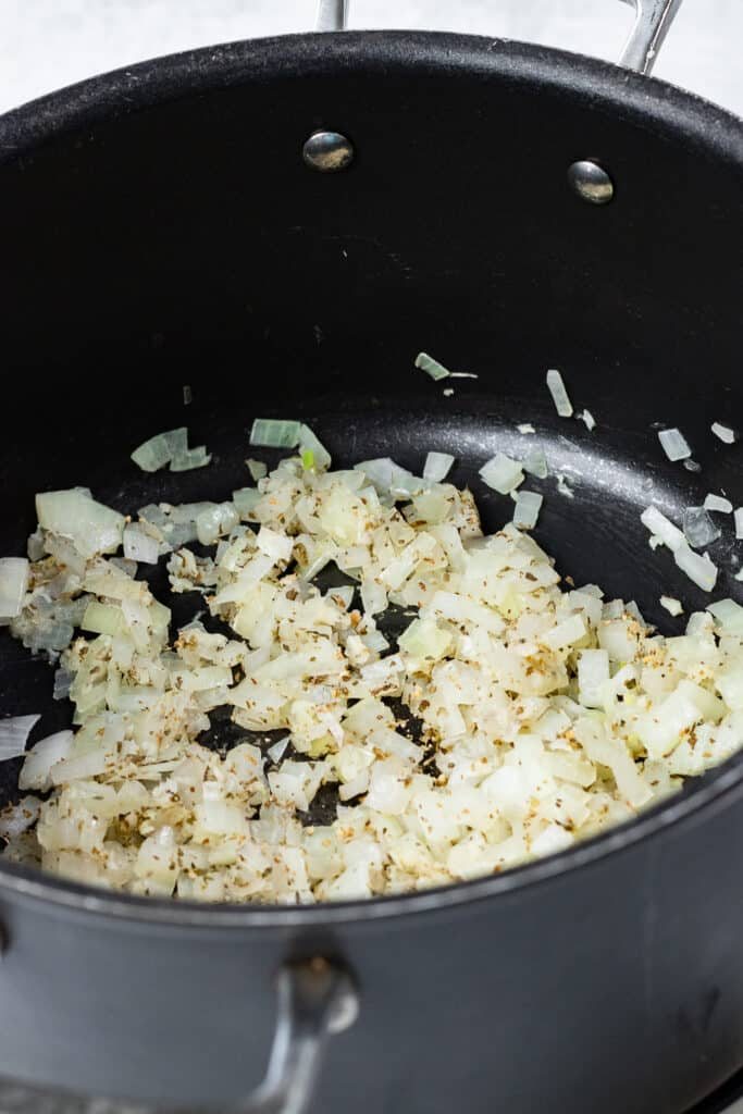Onions and garlic cooking down in a pot