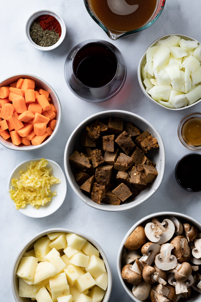 Seitan chunks and ingredients in bowls
