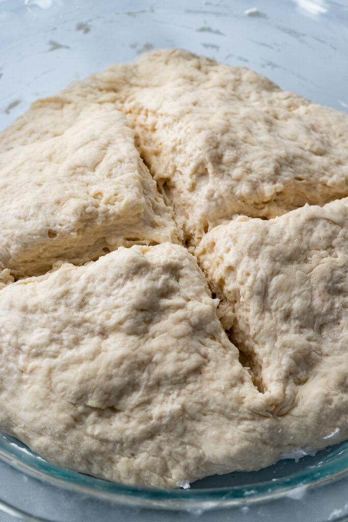 Dough in a pie dish cut to release air