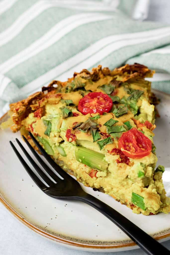 Slice of vegan quiche on a plate