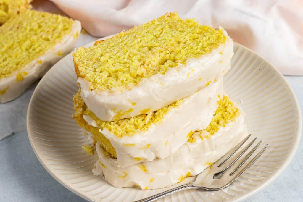Slices of Lemon Cake stacked on a plate