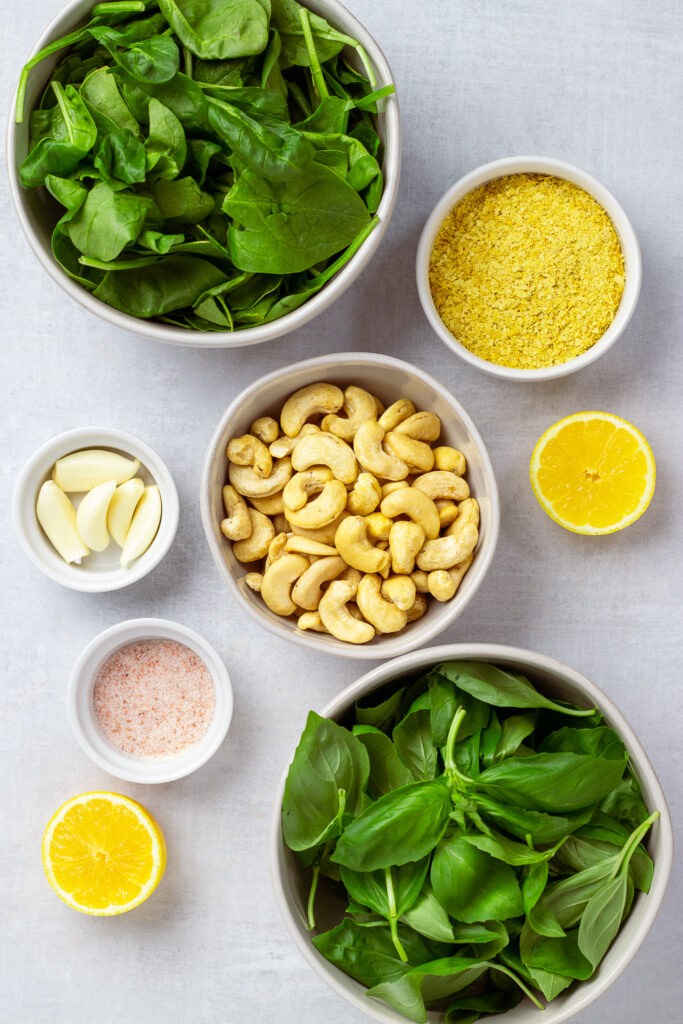 Cashews and greens in bowls