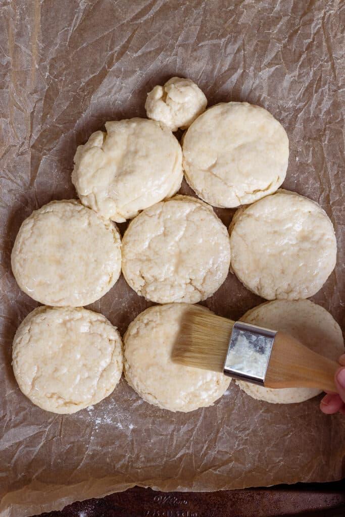 Basting the cut biscuits dough