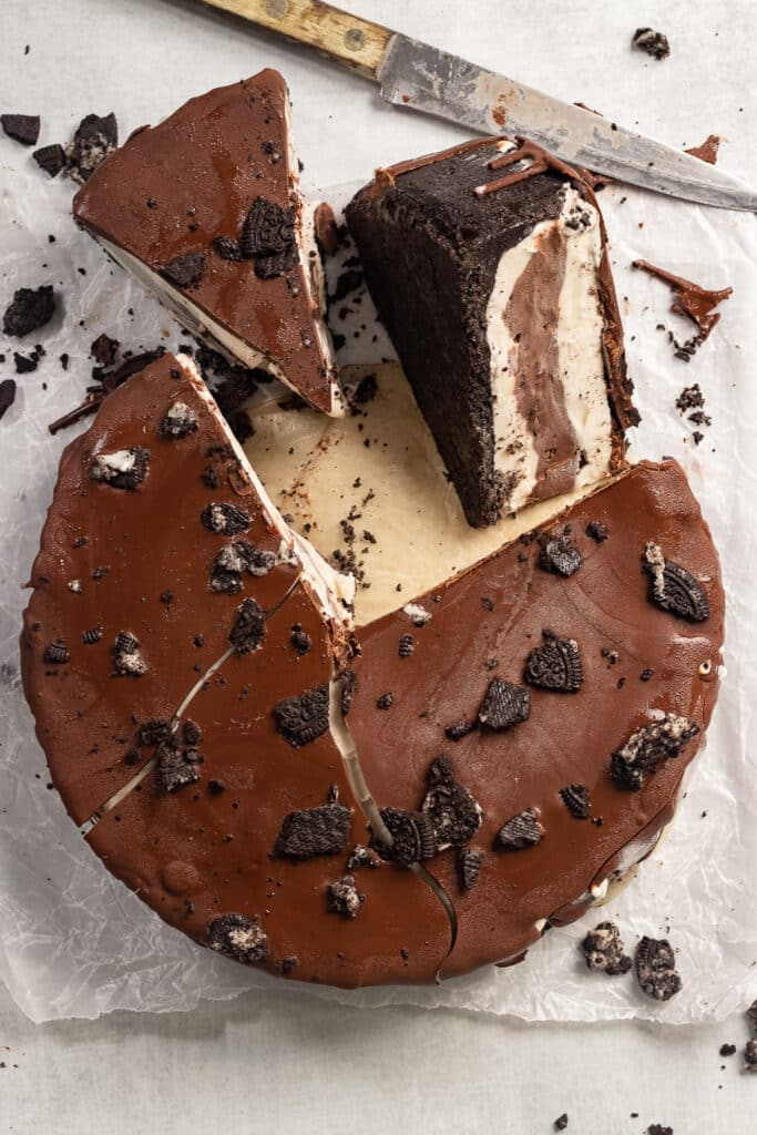 A cut ice cream cake with chocolate and vanilla layers