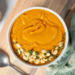 A bowl of vegan pumpkin and sweet potato soup